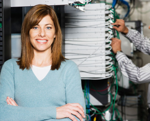 Computer Technicians in Server Room --- Image by © Royalty-Free/Corbis