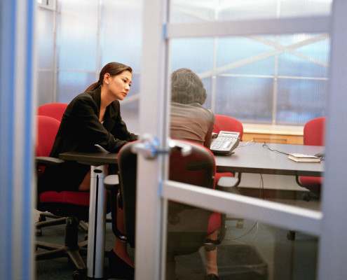 ca. 2001 --- Female Executives Meeting in a Conference Room --- Image by © Royalty-Free/Corbis