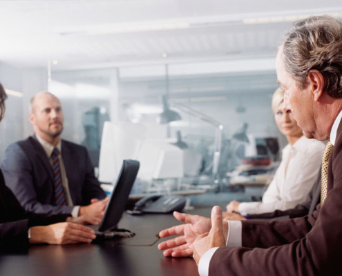 Businesspeople Meeting in a Conference Room --- Image by © Royalty-Free/Corbis