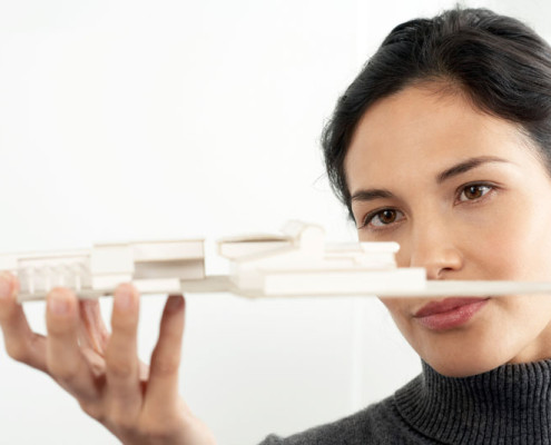 Architect Looking At Model --- Image by © Royalty-Free/Corbis